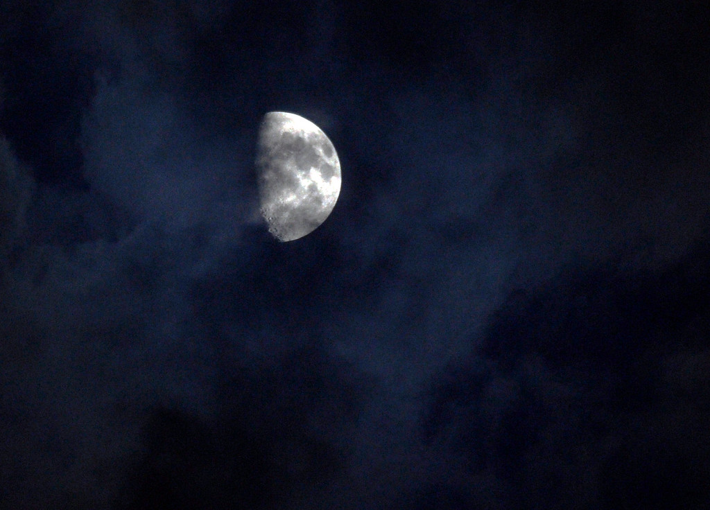 . HIGHLANDS RANCH, CO. - SEPTEMBER 13: The moon made a short appearance Friday night before it was obscured by clouds. The ThunderRidge High School football team hosted Grandview at Shea Stadium Friday night, September 13, 2013.  Photo By Karl Gehring/The Denver Post