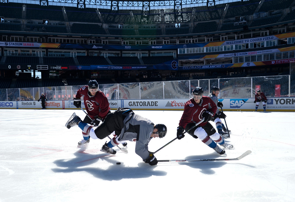 . Colorado Avalanche left wing Gabriel Landeskog (92) Colorado Avalanche center Mikhail Grigorenko (25) and Colorado Avalanche center Nathan MacKinnon (29) chase after the pucks during practice February 26, 2016 at Coors Field. (Photo By John Leyba/The Denver Post)