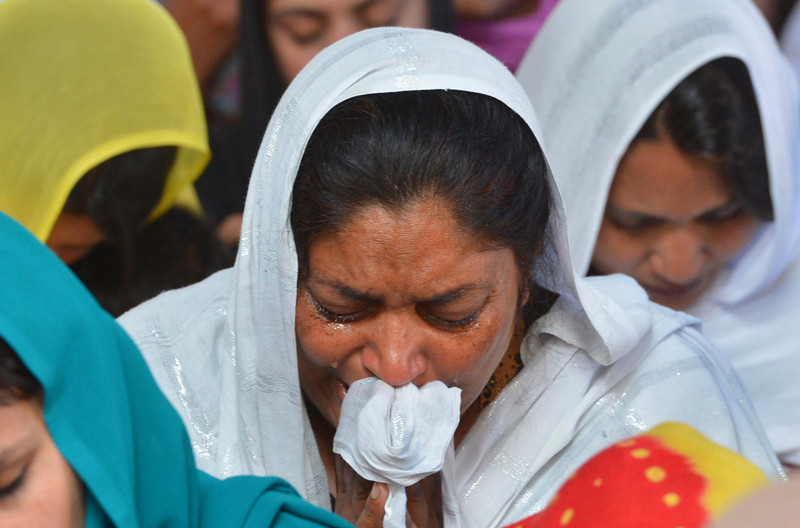 . Pakistani Christians attend a special Good Friday service at a Church in Peshawar on March 29, 2013. Christian believers around the world mark the Holy Week of Easter in celebration of the crucifixion and resurrection of Jesus Christ.  MAJEED/AFP/Getty Images