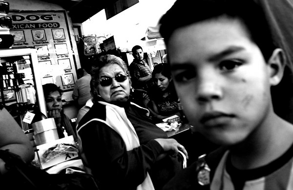 Grandma keeping watch on her mijo and he's keeping his eyes on moi.