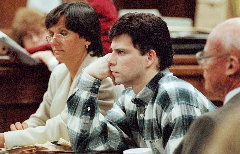. Lyle Menendez, with his lawyer Terri Towery, listens to testimony during trial proceedings in Los Angeles, March 28, 1996.  (AP Photo/Nick Ut)