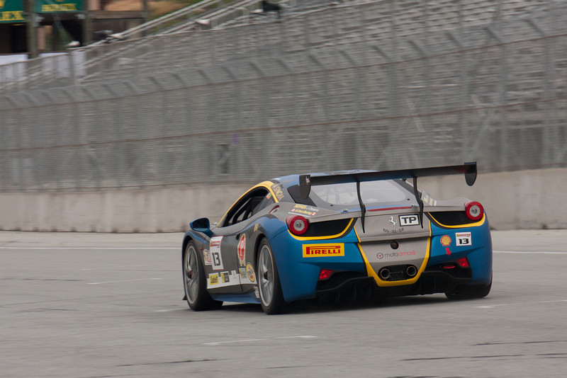 Marc Muzzo race down the front straight in the #13 Ferrari 458 EVO. © 2014 Victor Varela