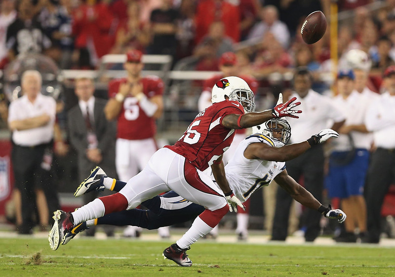. Wide receiver Eddie Royal #11 of the San Diego Chargers is unable to complete the pass against cornerback Jerraud Powers #25 of the Arizona Cardinals in the first quarter of the NFL game at the University of Phoenix Stadium on September 8, 2014 in Glendale, Arizona.  (Photo by Christian Petersen/Getty Images)