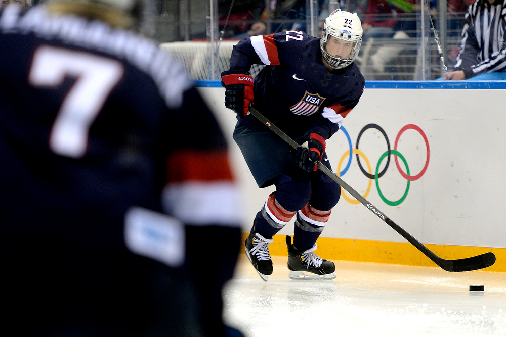 . U.S.A. player Kacey Bellamy prepares to pass to teammate Monique Lamoureaux during the third period of the United States\' 3-1 win against Finland. Sochi 2014 Winter Olympics on Saturday, February 8, 2014. (Photo by AAron Ontiveroz/The Denver Post)