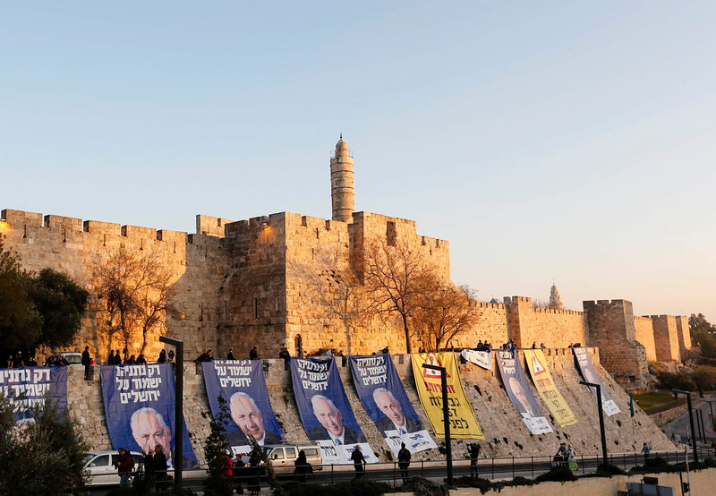 """. Campaign banners depicting Israel\'s Prime Minister Benjamin Netanyahu are seen after Likud-Yisrael Beitenu activists draped them on walls surrounding Jerusalem\'s Old City January 20, 2013. Netanyahu said on Saturday a country with as many enemies as Israel cannot afford a weak ruling party, after polls ahead of Tuesday\'s parliamentary election showed a slide in his support. The banners read (L and C) \""""Only Netanyahu will protect Jerusalem\"""" and \""""Warning! \'67 borders ahead\"""". REUTERS/Ronen Zvulun"""