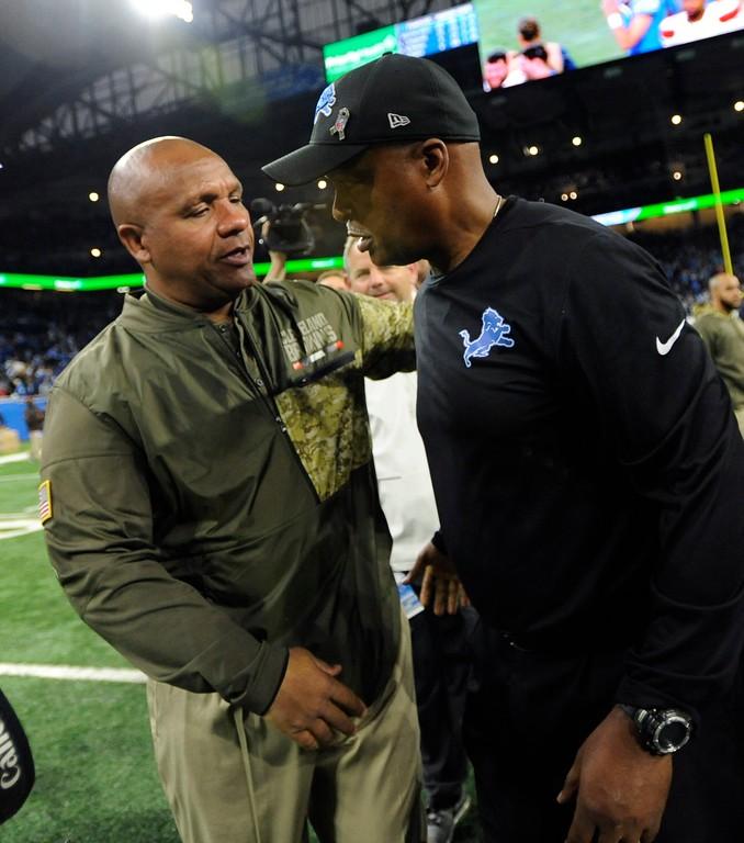 . Cleveland Browns head coach Hue Jackson, left, greets Detroit Lions head coach Jim Caldwell after their NFL football game, Sunday, Nov. 12, 2017, in Detroit. (AP Photo/Jose Juarez)