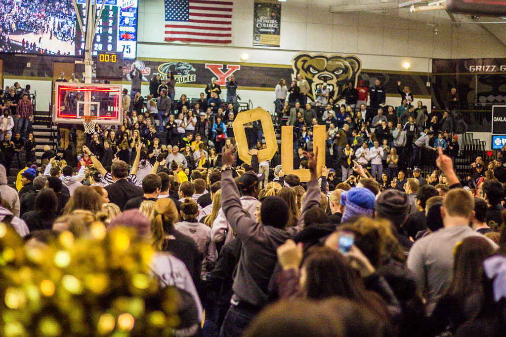 . Fans, students storm the court after Mondy\'s three point buzzer-beater. Photos by Dylan Dulberg/The Oakland Press