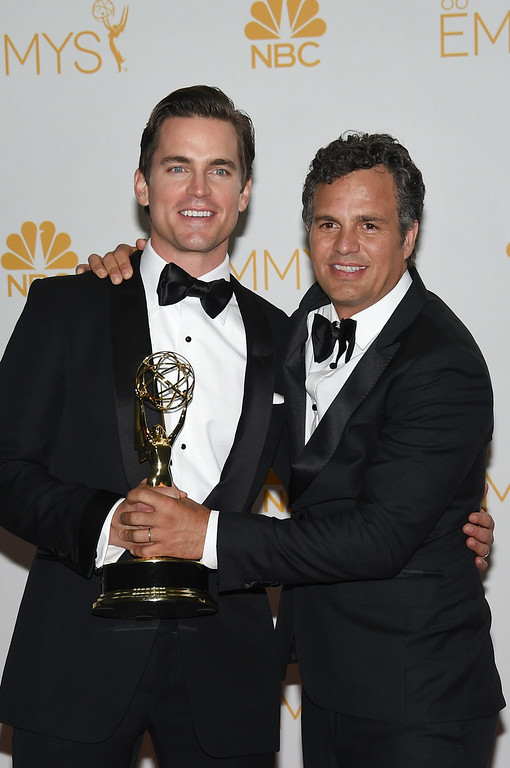 ". Actor Matt Bomer (L) and Mark Ruffalo, winners of the Outstanding Television Movie for ""The Normal Heart\"" pose in the press room during the 66th Annual Primetime Emmy Awards held at Nokia Theatre L.A. Live on August 25, 2014 in Los Angeles, California.  (Photo by Jason Merritt/Getty Images)"