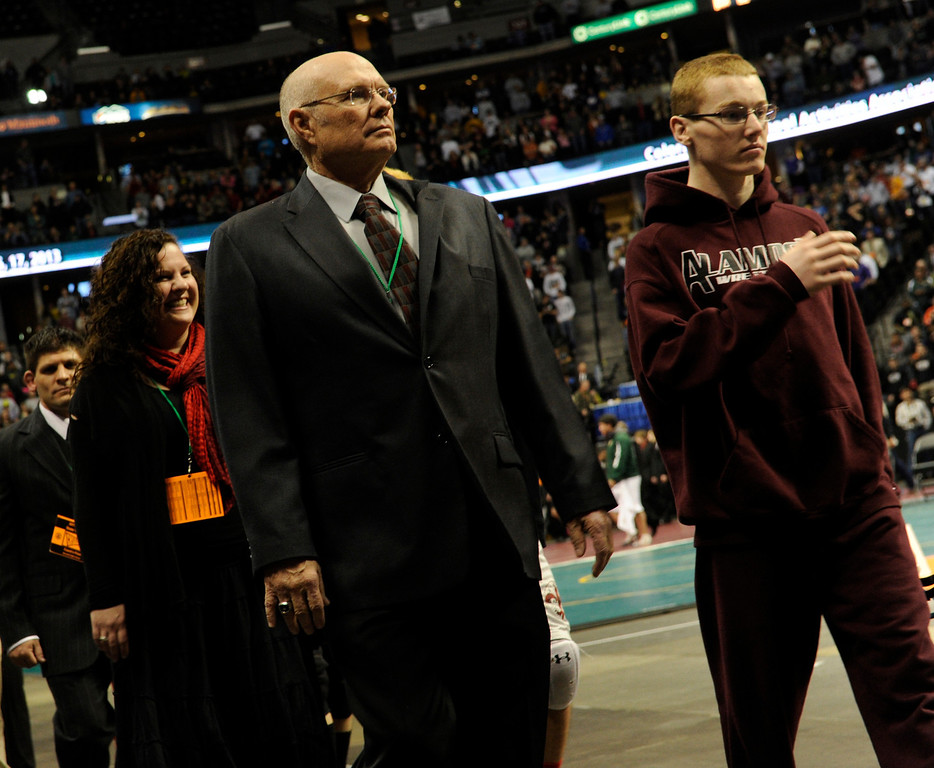 . DENVER, CO. - FEBRUARY 23: Alamosa wrestling coach Gary Ramstetter, left, walked in the Parade of Champions with senior Neff Malouff Saturday night. Alamosa will take the 3A team title this year. The CHSAA State Wrestling Tournament wrapped up, February 23, 2013, with final matches following the Parade of Champions at the Pepsi Center in downtown Denver. (Photo By Karl Gehring/The Denver Post)