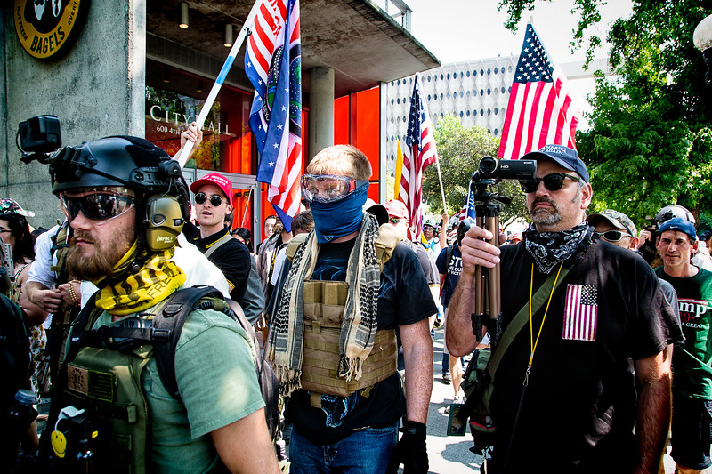 """Members of the far right rally, """"Liberty or Death"""" prepare to march, under police escort, around several blocks in Seattle."""