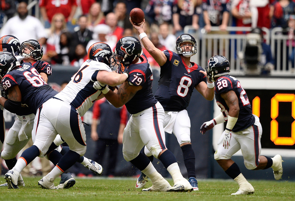 . Houston Texans quarterback Matt Schaub (8) throws a pass against the Denver Broncos during the first quarter December 22, 2013 at Reliant Stadium. (Photo by John Leyba/The Denver Post)
