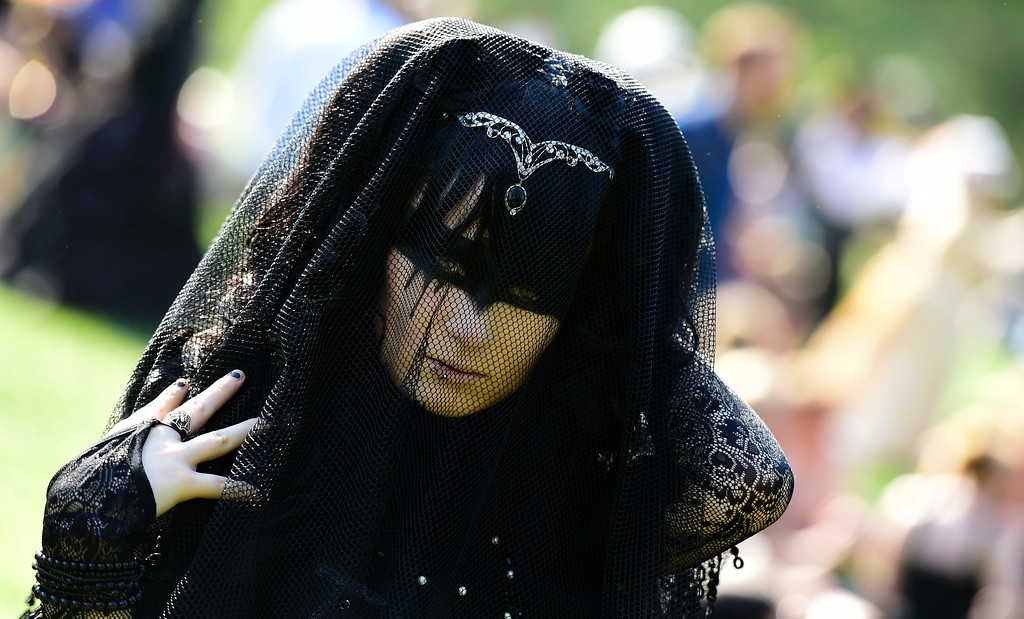 """. A dressed up woman attends a so-called \""""Victorian Picnic\"""" during the Wave-Gotik-Treffen (WGT) festival in Leipzig, eastern Germany, on May 13, 2016.   / AFP PHOTO / TOBIAS SCHWARZ/AFP/Getty Images"""