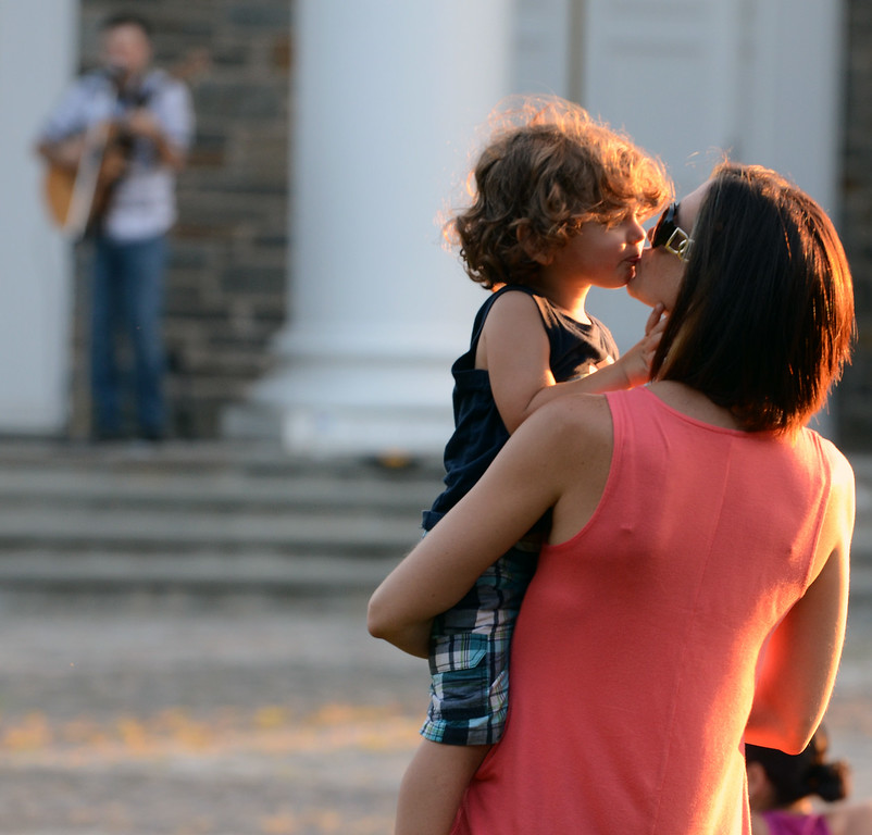 . Valerie Adams gets a kiss from her son Levi ,2, as they dance around with musician Bobby Jo Valentine performing an outdoor concert on the front steps of Trinity Lutheran Church in Lansdale  on Wednesday evening August 27,2014. Photo by Mark C Psoras/The Reporter