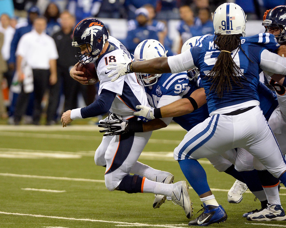 . Denver Broncos quarterback Peyton Manning (18) gets sacked by Indianapolis Colts defensive end Fili Moala (95) during the fourth quarter October 20, 2013 at Lucas Oil Field. Photo by John Leyba/The Denver Post)
