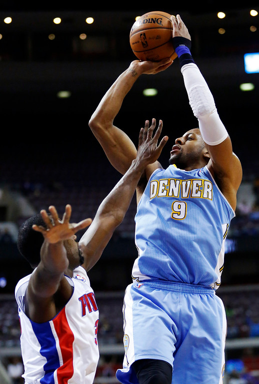 . Denver Nuggets guard Andre Iguodala (9) shoots against Detroit Pistons guard Rodney Stuckey (3) in the second half of an NBA basketball game, Tuesday, Dec. 11, 2012, in Auburn Hills, Mich. Iguodala scored 12 points in their 101-94 win. (AP Photo/Duane Burleson)
