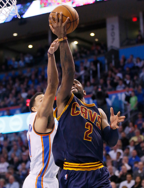 . Cleveland Cavaliers guard Kyrie Irving (2) shoots in front of Oklahoma City Thunder forward Andre Roberson during the second quarter of an NBA basketball game in Oklahoma City, Thursday, Feb. 9, 2017. (AP Photo/Sue Ogrocki)