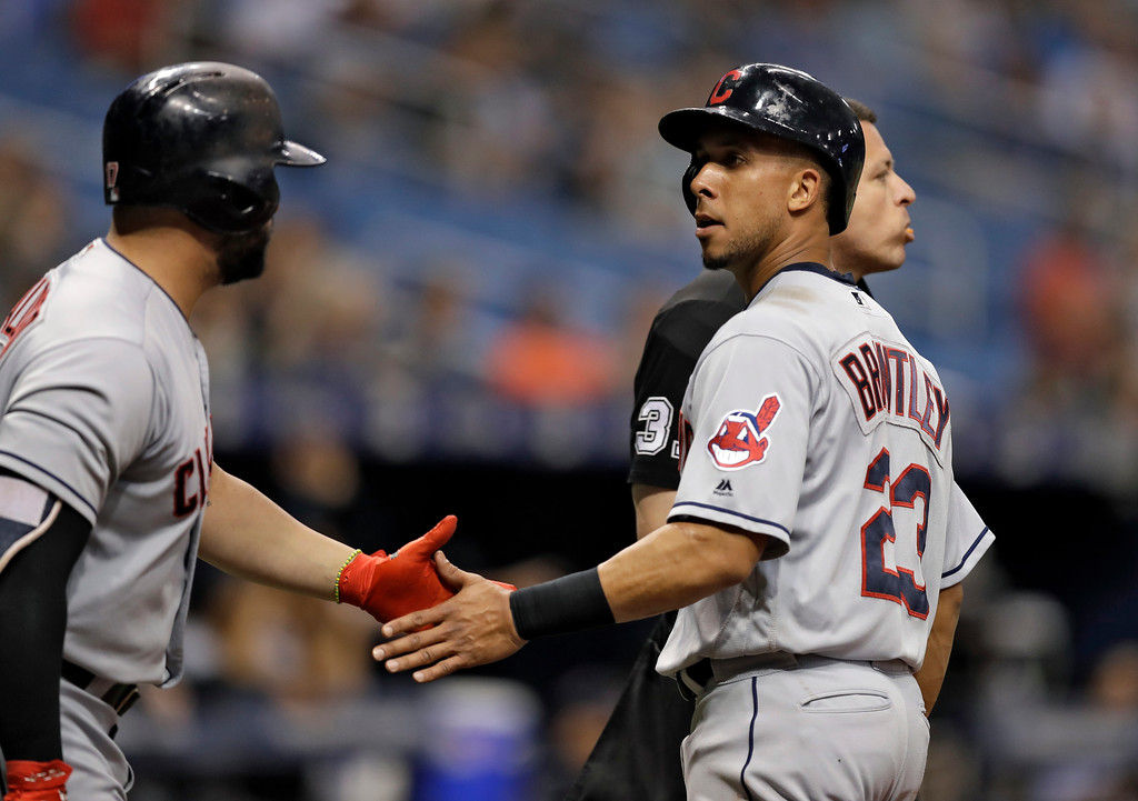 . Cleveland Indians\' Michael Brantley, right, celebrates with Yonder Alonso after scoring on an RBI single by Edwin Encarnacion off Tampa Bay Rays pitcher Diego Castillo during the first inning of a baseball game Monday, Sept. 10, 2018, in St. Petersburg, Fla. (AP Photo/Chris O\'Meara)