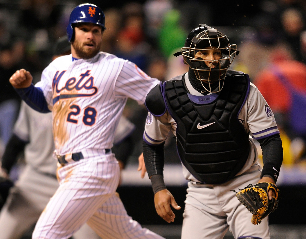. DENVER, CO. - APRIL 16:  Mets baserunner Daniel Murphy crossed the plate ahead of the throw to Yorvit Torrealba in the fifth inning. Marlon Byrd singled in the run to make the score 5-2 in the fifth inning. The Colorado Rockies hosted the New York Mets in the second game of a doubleheader Tuesday night, April 16, 2013. Monday night\'s game was snowed out at Coors Field.  Photo By Karl Gehring/The Denver Post)