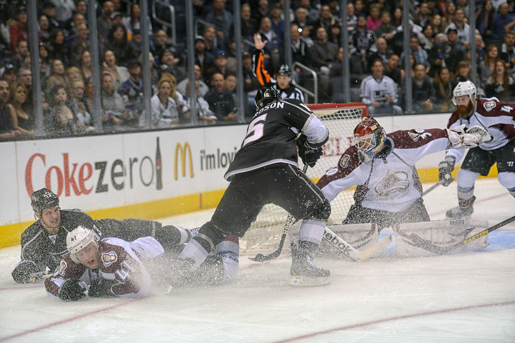 . The Kings\' Brad Richardson #15 looks to shoot as Avalanche goalie  Sami Aittokallio #30 defends during first period action at the Staples Center Thursday, April 11, 2013.(Hans Gutknecht/Staff Photographer)