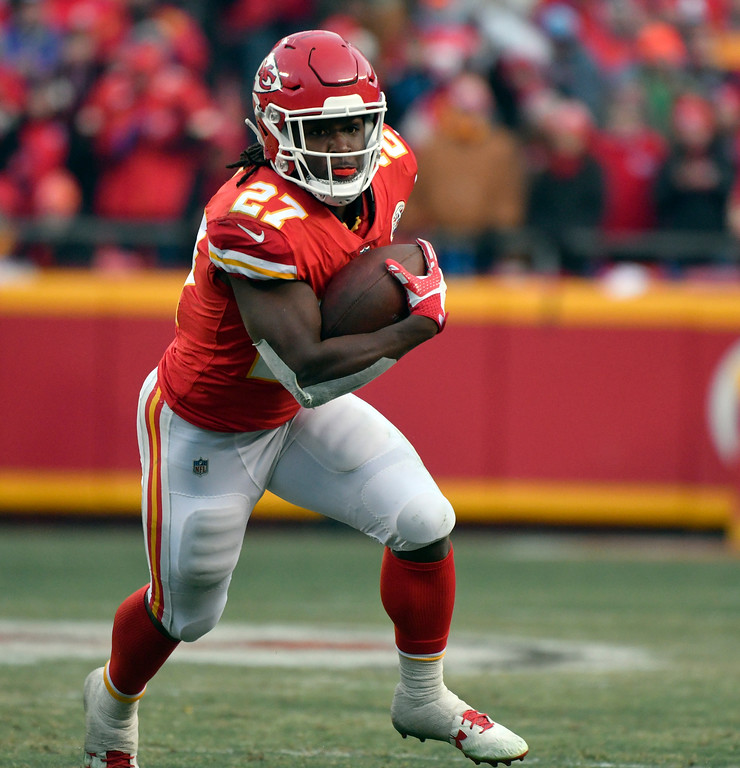 . Kansas City Chiefs running back Kareem Hunt (27) carries the ball during the first half of an NFL wild-card playoff football game against the Tennessee Titans, in Kansas City, Mo., Saturday, Jan. 6, 2018. (AP Photo/Ed Zurga)
