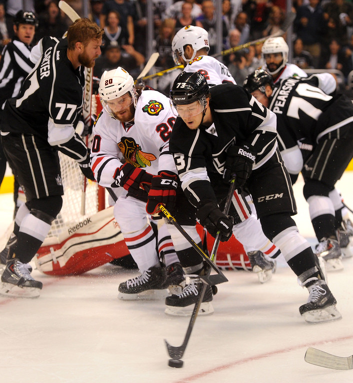 . The Kings\' Tyler Toffoli gets the puck in front of the Blackhawks\' Brandon Saad during game six of the Western Conference Finals, Friday, May 30, 2014, at Staples Center. (Photo by Michael Owen Baker/Los Angeles Daily News)