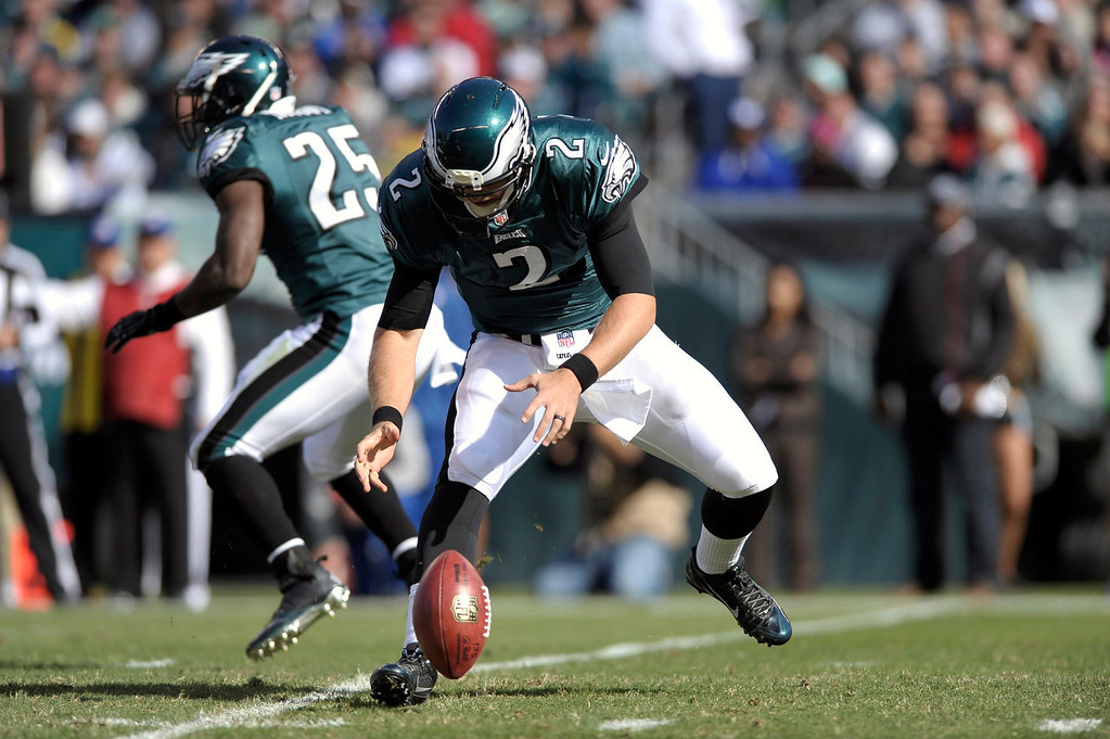 . Philadelphia Eagles quarterback Matt Barkley (2) loses control of the ball during the first half of an NFL football game against the New York Giants Sunday, Oct. 27, 2013 in Philadelphia. (AP Photo/Michael Perez)