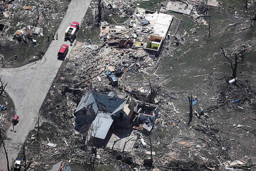 . In this aerial photo, emergency personnel are seen in the small town of Fairdale, Ill., in DeKalb County on Friday, April 10, 2015, after a tornado swept through the area the night before. The National Weather Service says at least two tornadoes churned through six north-central Illinois counties. Illinois Gov. Bruce Rauner on Friday declared DeKalb and Ogle counties affected by the severe storms and tornadoes as disaster areas.  (AP Photo/Daily Chronicle, Danielle Guerra)