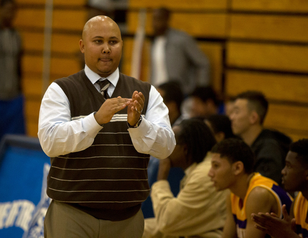 . Oakland Technical High School head coach Karega Hart tries to encourage his players during the third quarter of their Oakland Athletic League semi-final tournament game against Oakland High, Tuesday, Feb. 26, 2013 in Oakland, Calif. Oakland won, 70-58. (D. Ross Cameron/Staff)