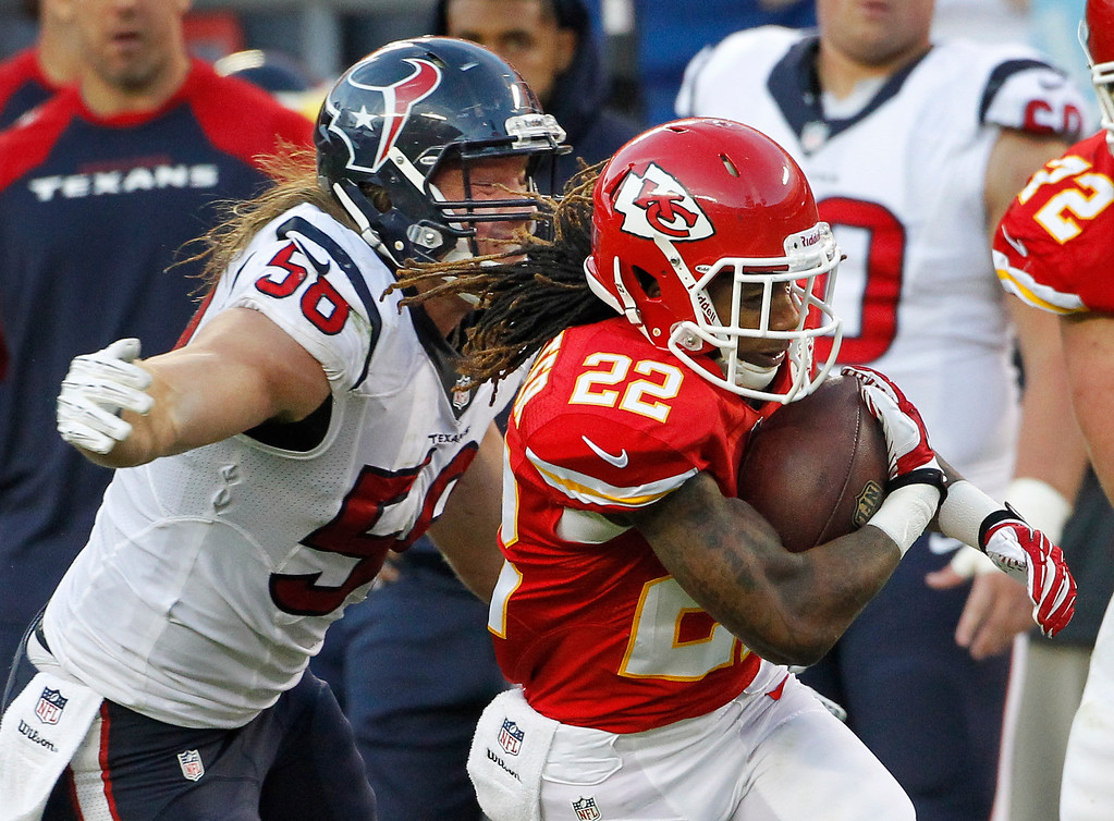 . Kansas City Chiefs wide receiver Dexter McCluster (22) is tackled by Houston Texans inside linebacker Brian Cushing (56) during the second half of an NFL football game at Arrowhead Stadium in Kansas City, Mo., Sunday, Oct. 20, 2013. (AP Photo/Colin E. Braley)