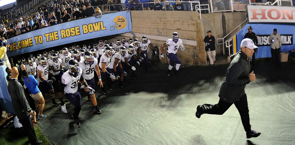 . Washington Huskies head coach Steve Sarkisian leads his team on to the field prior to their college football game against UCLA Bruins in the Rose Bowl in Pasadena, Calif., on Friday, Nov. 15, 2013.  UCLA won 41-31.   (Keith Birmingham Pasadena Star-News)