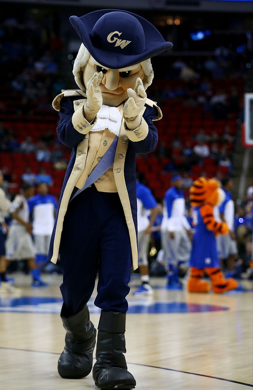. George Washington Colonials mascot, George, performs in the first half against the Memphis Tigers during the Second Round of the 2014 NCAA Basketball Tournament at PNC Arena on March 21, 2014 in Raleigh, North Carolina.  (Photo by Streeter Lecka/Getty Images)