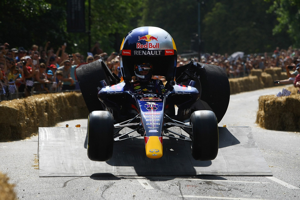 . Christian Horner, Team Principal of the Infiniti Red Bull Racing Formula One team, goes over a jump in the Red Bull racing soapbox racer during the Red Bull Soapbox Race at Alexandra Palace on July 14, 2013 in London, England. The Red Bull Soapbox Race returned to London after nine years and encourages competitors to build and race their own homemade soapboxes down a hill.  (Photo by Jordan Mansfield/Getty Images)