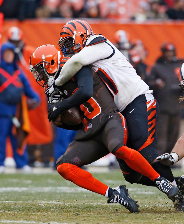 . Cincinnati Bengals defensive tackle Geno Atkins (97) sacks Cleveland Browns quarterback Robert Griffin III (10) in the second half of an NFL football game, Sunday, Dec. 11, 2016, in Cleveland. (AP Photo/Ron Schwane)