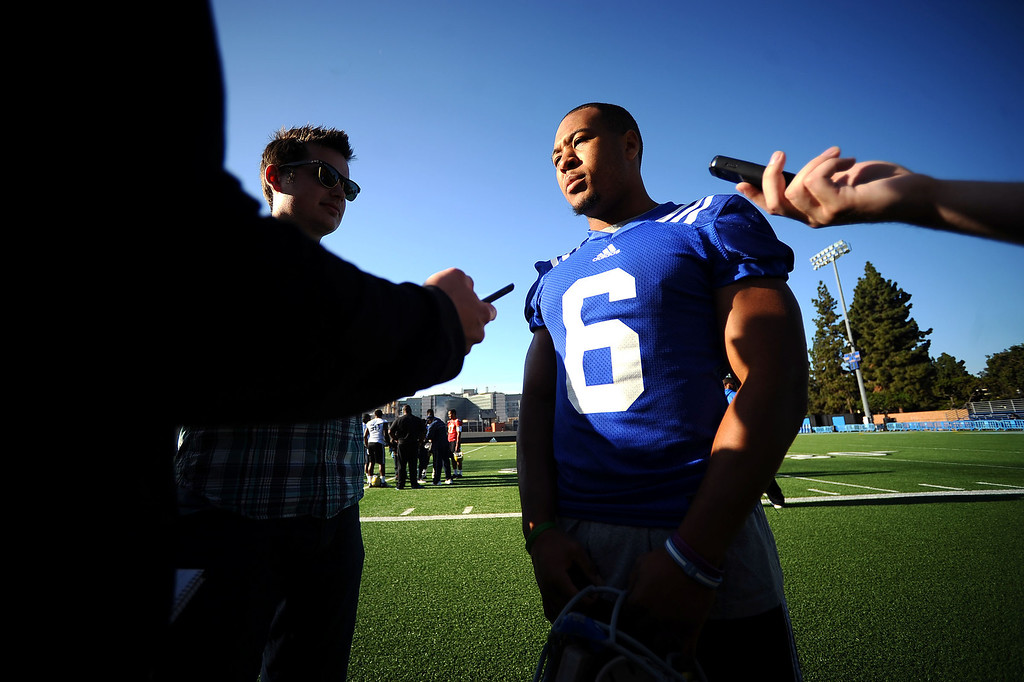 . UCLA\'s Jordon James speaks to members of the media following the final day of spring practice Thursday, April 24, 2014.(Andy Holzman/Los Angeles Daily News)