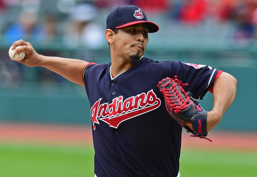 . Cleveland Indians starting pitcher Carlos Carrasco throws in the first inning of a baseball game against the Milwaukee Brewers, Wednesday, June 6, 2018, in Cleveland. (AP Photo/David Dermer)