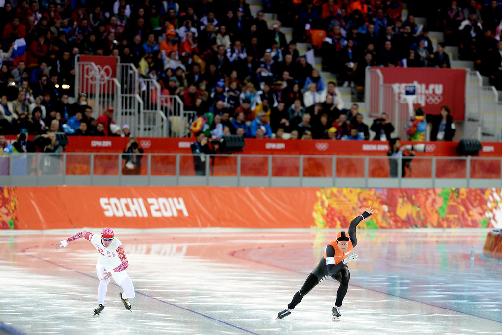 . Bronze medalist Ronald Mulder (right) leads Russia\'s Aryom Kuznetsov during the speed skating men\'s 500-meter at Adler Arena. Sochi 2014 Winter Olympics on Monday, February 10, 2014. (Photo by AAron Ontiveroz/The Denver Post)