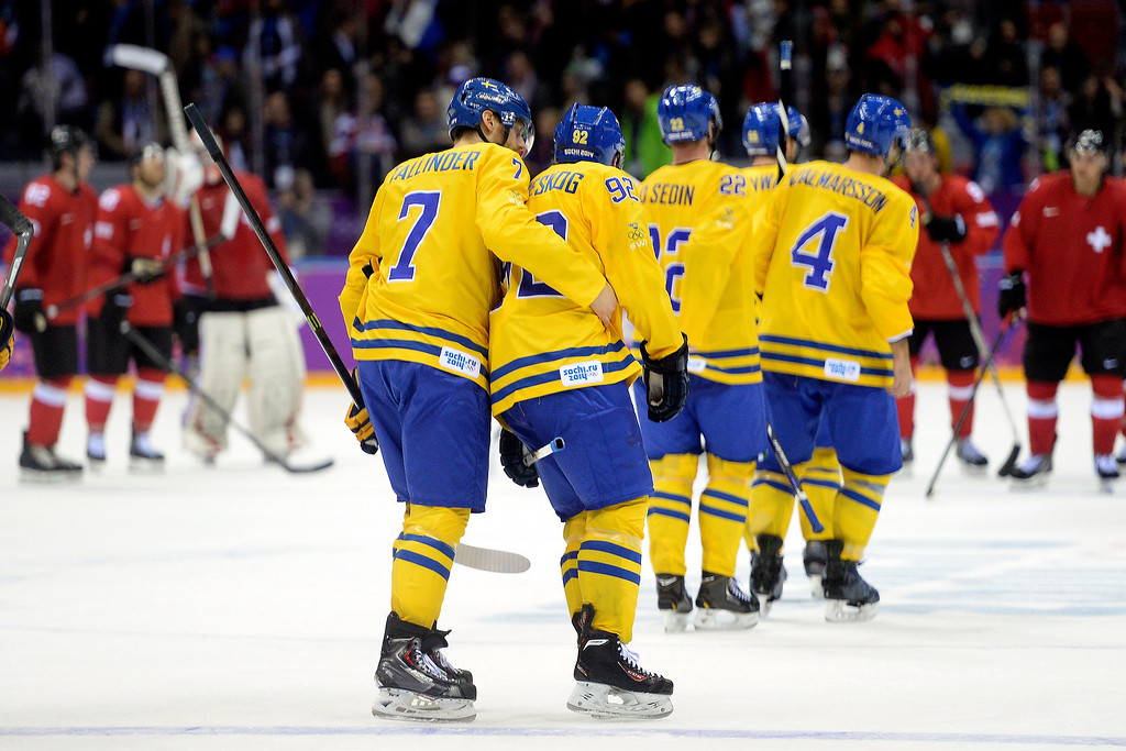 . Sweden\'s Henrik Tallinder puts his arm around teammate Gabriel Landeskog after the third period of Sweden\'s 1-0 preliminary round group C win over Switzerland at Bolshoy Arena. Sochi 2014 Winter Olympics on Friday, February 14, 2014. (Photo by AAron Ontiveroz/The Denver Post)
