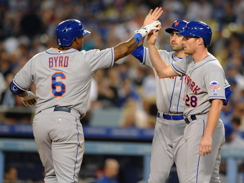 . Mets Marlon Byrd is congratulated on his 3 run homer in the 3rd inning by teammates  Josh Satin and Daniel Murphy. The Dodgers played the New York Mets in a game at Dodger Stadium in Los Angeles, CA. 8/13/2013(John McCoy/LA Daily News)