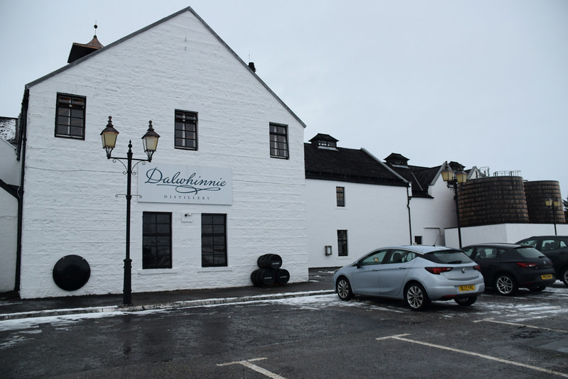 white building with pitched roof and Dalwhinnie Distillery sign
