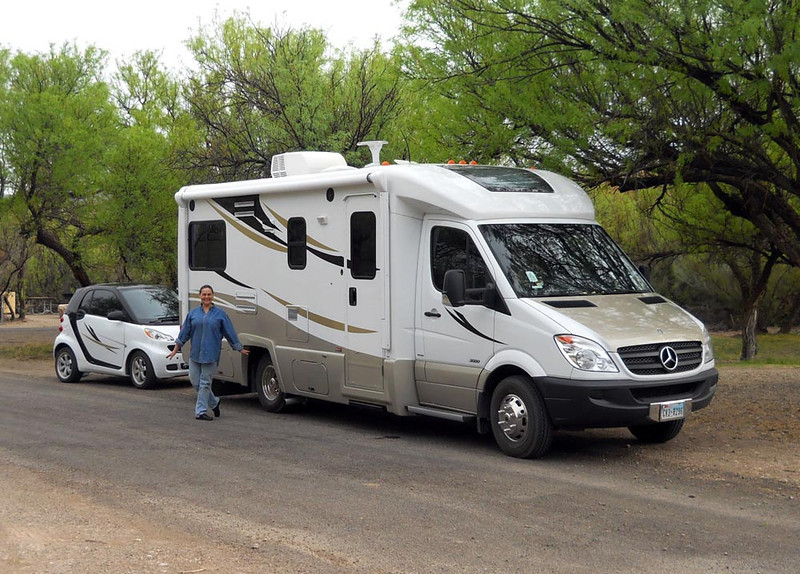 LYNNE POSING IN FRONT OF THE RIG Funnily enough, the first time I met Lynne was here at Big Bend during a photo workshop in 1986, and here we are again. The Universe is a wondrous place. The Mercedes-Benz RV's name is Benzi, while the little Smart Car tow vehicle's name is Smarty. How about those matching paint schemes?