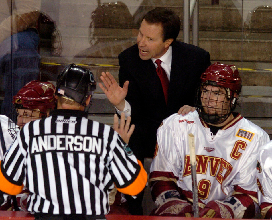 . Denver University Pioneers head coach, George Gwozdecky, has a few words with referee Todd Anderson while leaning on Gabe Gauthier\'s shoulder during the second period against the Minnesota Golden Gophers at Magness Arena Saturday evening.  THE DENVER POST/ ANDY CROSS