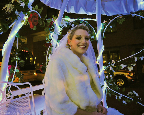 Winter bride waiting for her carriage to bring her to her wedding at the OnCenter Convention Center in Syracuse, New York.