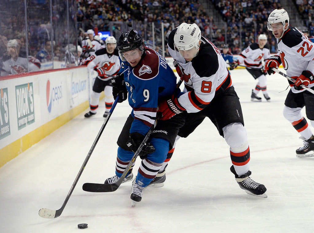 . Colorado Avalanche center Matt Duchene (9) and New Jersey Devils right wing Dainius Zubrus (8) race to the puck during the first period January 16, 2014 at Pepsi Center. (Photo by John Leyba/The Denver Post)