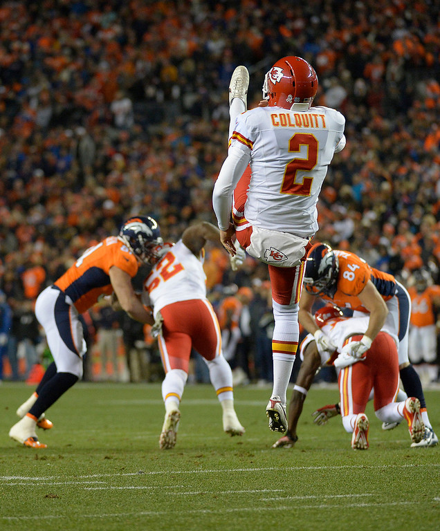 . Kansas City Chiefs punter Dustin Colquitt (2) gets a punt off in the first quarter. The Denver Broncos take on the Kansas City Chiefs at Sports Authority Field at Mile High in Denver on November 17, 2013. (Photo by John Leyba/The Denver Post)