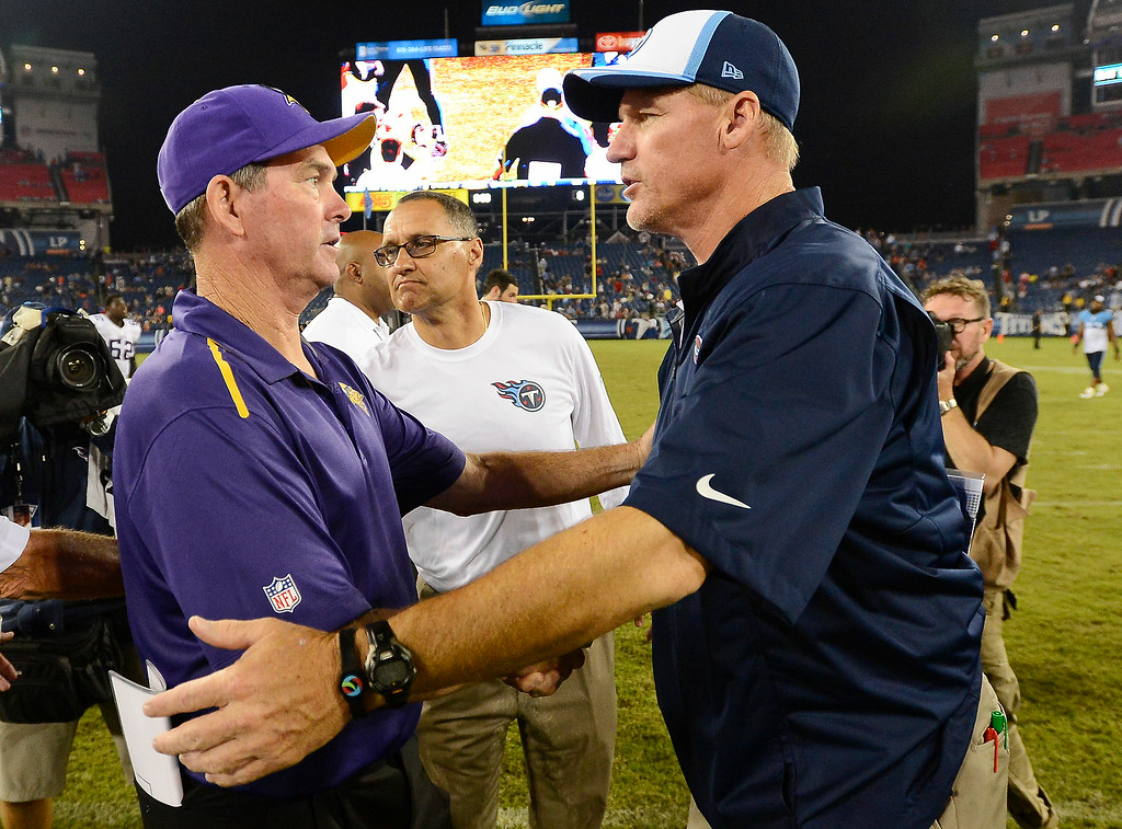 . Tennessee Titans head coach Ken Whisenhunt, right, congratulates Minnesota Vikings head coach Mike Zimmer, left,  for his team\'s 19-3 win over the Titans. (AP Photo/Mark Zaleski)