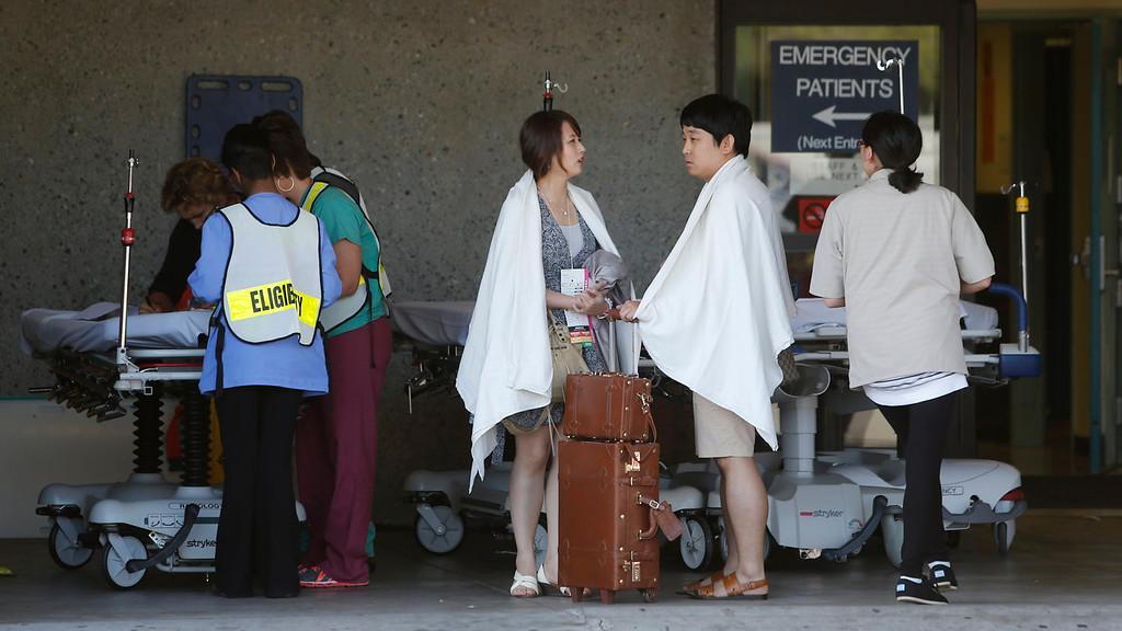 . Passengers from Asiana Flight 214 are treated at San Francisco General Hospital after the plane crashed at San Francisco International Airport in San Francisco, Saturday, July 6, 2013. (AP Photo/Bay Area News Group, John Green)