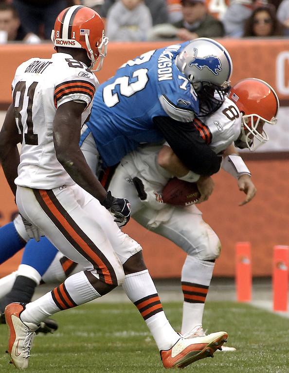 . News-Herald file Browns quarterback Trent Dilfer is sacked for a loss by Detroit\'s Dan Wilkinson during the browns final drive in the fourth quarter of Sunday\'s 13-10 Browns loss at Cleveland Browns Stadium.