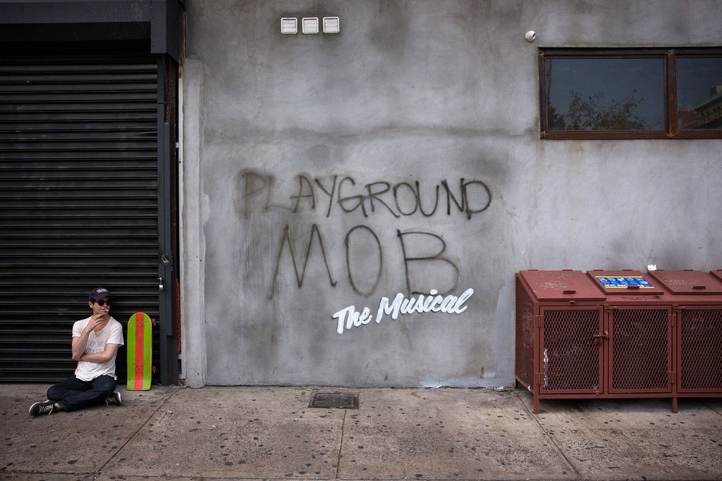 ". Street art reading, ""Playground Mob, The Musical,\"" allegedly done by the British street artist Banksy, is seen in the Lower East Side on October 4, 2013 in New York City.  Earlier this week Banksy announced he would be creating new street art for a month in New York.  (Photo by Andrew Burton/Getty Images)"