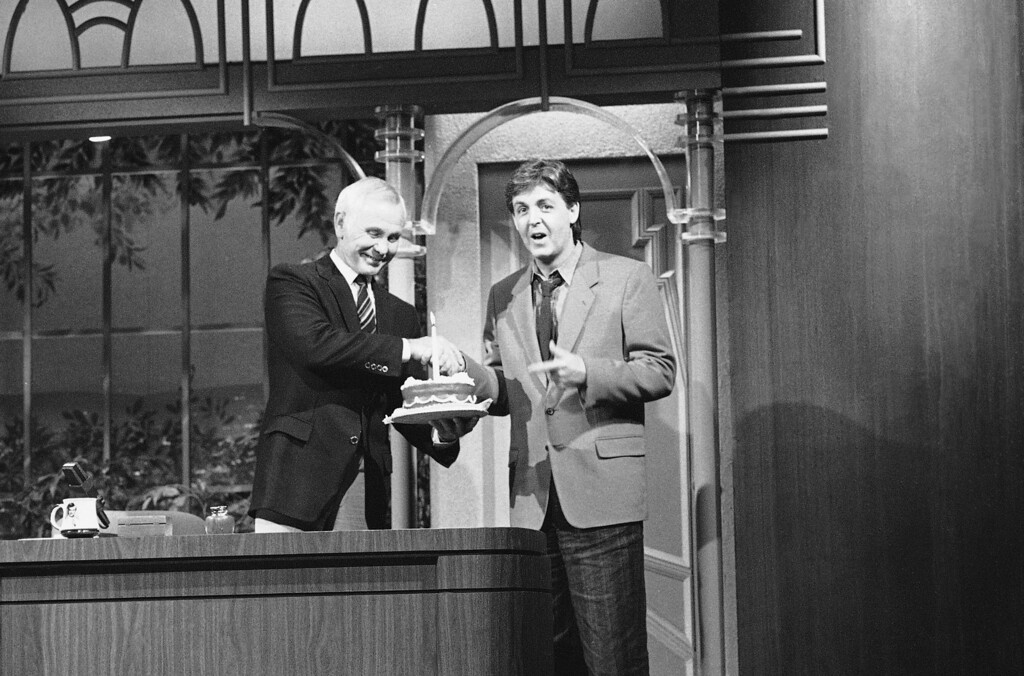 . Entertainer Paul McCartney presents Johnny Carson with a birthday cake during the taping of the �tonight Show,� at NBC�s Burbank, Calif. Studios on Tuesday, Oct. 23, 1984, honoring Carson�s 59th birthday today. (AP Photo/Nickut)