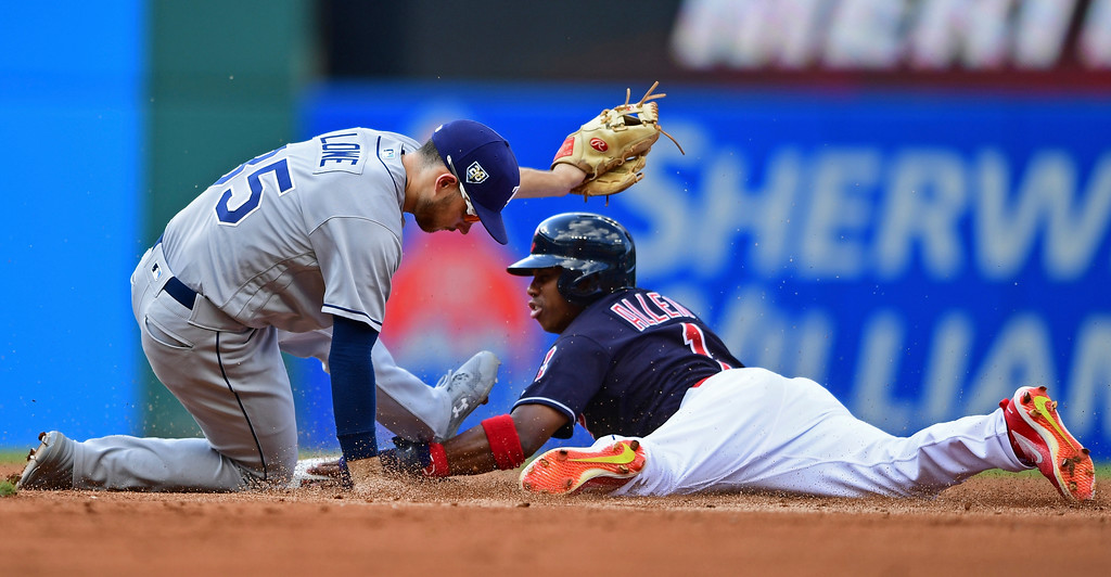 . Tampa Bay Rays\' Brandon Lowe tags out Cleveland Indians\' Greg Allen at second base on an attempted steal in the third inning of a baseball game, Sunday, Sept. 2, 2018, in Cleveland. (AP Photo/David Dermer)